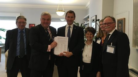 Health secretary Jeremy Hunt, centre, with district councillor Tony Hunt, NE Herts MP Sir Oliver Hea