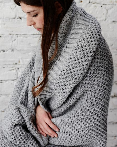 Shades of grey: Olso knitted throw from Also Home. Theyre chunky, timeless in grey or bold lime and,