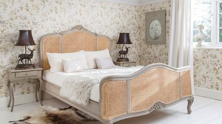 Elegance: This Normandy rattan painted bed from the The French Bedroom Company exhudes elegance in h