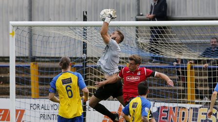 St Albans City's Dean Snedker claims a high ball. Picture: LEIGH PAGE