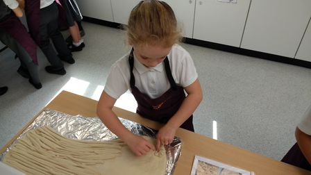 Tannery Drift First School Year 3 pupil Laura O'Connor making harvest bread. Picture: Tannery Drift