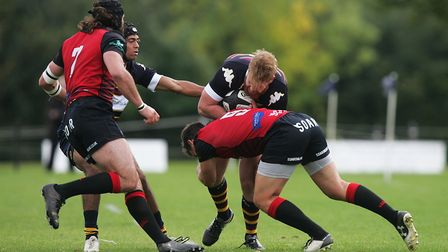 Jono Midghall takes the hit from Birmingham Moseley's Rob Lewis. Picture: KARYN HADDON