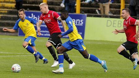 Percy Kiangebeni charges through the Bridport defence as he prepares to put St Albans City into a tw