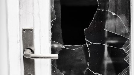 The rear door to the property was smashed in. Photo: VAMPIRICA