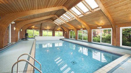 The indoor swimming pool complex has doors opening out to the patio and garden area