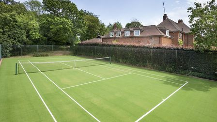 The tennis court is one of the property's stand out features