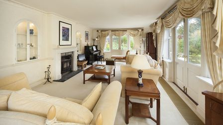 The spacious drawing room has fine views of the garden