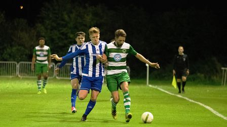 Eynesbury defender Curtis Hartley battles for the ball against Newport Pagnell on Monday night. Pict