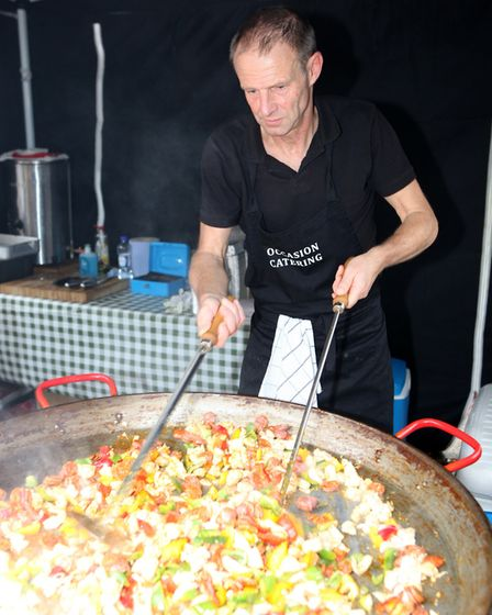 A cook stirs up a large paella during the St Albans Food and Drink Festival 2017Picture: Craig She