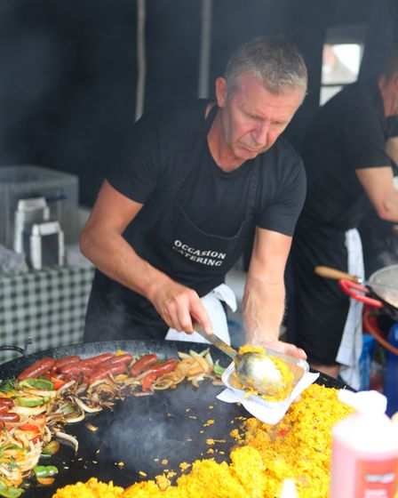 A man serves a portion of paella during the St Albans Food and Drink Festival 2017Picture: Craig S