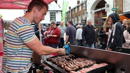 A market stall holder cooks his sausages for the food festival goers.Picture: Craig Shepheard