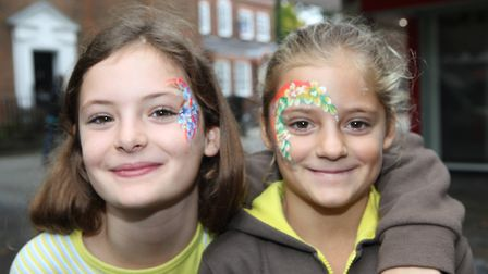 Emily Sharp (8) and her sister Annie (7) had their faces painted during the St Albans food festival.