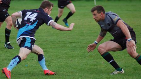 St Neots man Dave Hopkins attempts to evade a tackle against Stamford College Old Boys. Picture: CAR