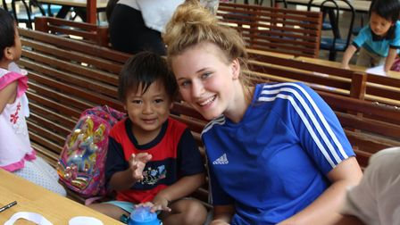 Katie Myerscough with a youngster in Malaysia. Picture: BVC