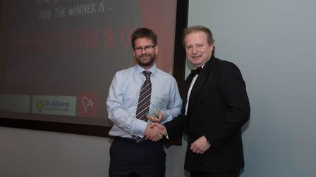 Luke Godfrey being presented with the sustainability award by Cllr Beric Read.