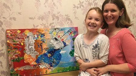 Charlotte McLachlan with mum Pip and the Royston Arts Fesitval cover artwork. Picture: Pip McLachlan