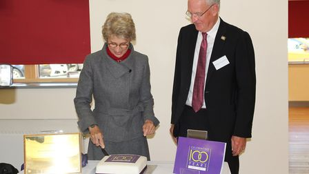 The Duchess of Gloucester cuts the cake to celebrate the trust's 100th birthday.