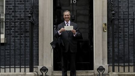 Nigel Farage the leader of Britain's Brexit Party poses for photographers outside 10 Downing Street.
