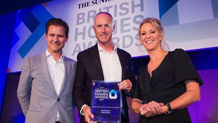 James Moody, MD of Meyer Homes (centre) picking up the British Homes Award for Gabriel Square