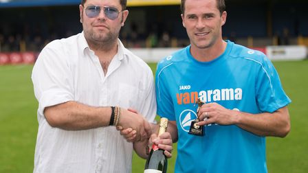 St Albans City's Ben Herd receives the September player of the month award from Lee Wood, managing d