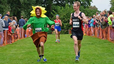Robin Todd approaches the finish in his record-breaking feat at the Northampton Half Marathon, accom