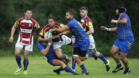 Daniel Townson is hauled down by the Verulamians defence. Picture: KARYN HADDON