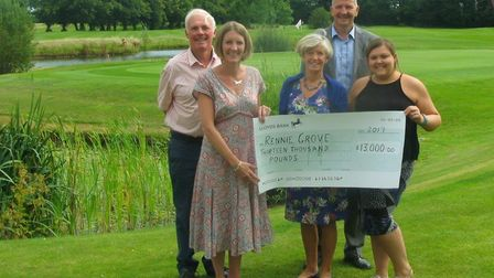 The presentation of funds raised at the Mike Hodge charity golf day.