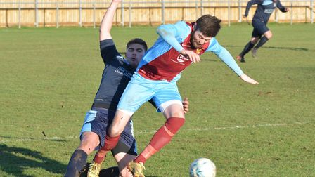 Lee Bassett scored but saw a penalty saved as Eaton Socon went out of the Cambs Invitation Cup.