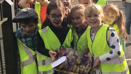 Children from Therfield First School out delivering their homemade. Picture: Therfield First School