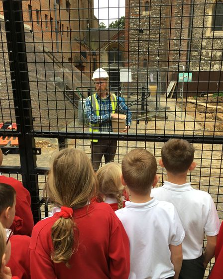 Ross Lane talking to school children at the St Albans Cathedral dig.