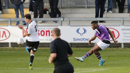 Shaun Lucien fires the ball across the Dartford penalty area. Picture: LEIGH PAGE