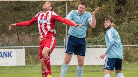 Captain Tom Moran gets his head on the ball for Godmanchester Rovers. Picture: J BIGGS PHOTOGRAPHY