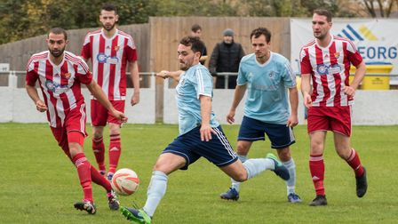 Player-coach Chris Hyem on the ball for Godmanchester Rovers as brother, Micky, looks on. Picture: J