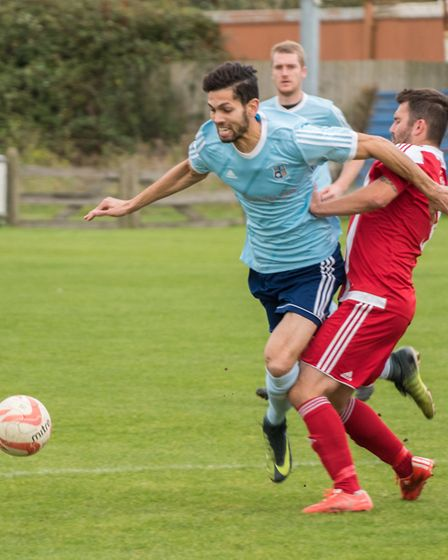 Godmanchester Rovers man Zac Knight-Percival battles for the ball. Picture: J BIGGS PHOTOGRAPHY