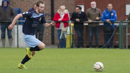 Tom Meechan races in to score the winner for St Neots Town against Corby Town. Picture: CLAIRE HOWES