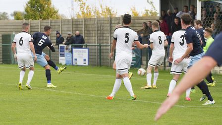 Liam McDevitt (5) fires St Neots Town's leveller against Corby Town. Picture: CLAIRE HOWES