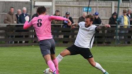 Scott Thomas goes in for a tackle against Enfield Town. Picture: Danny Loo