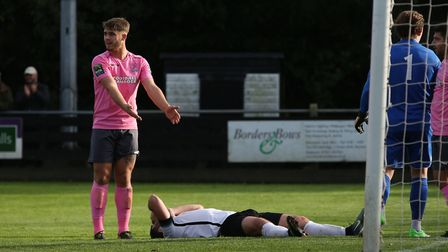John Frendo lies on the floor holding his head after missing a good chance. Picture: Danny Loo