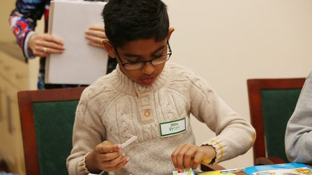 Children make robot magnets at the Razzamatazz Robots Holiday Club. Picture: Danny Loo