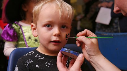 Joshua Moulds, four,has his face painted at The Light Party organised by volunteers from Churches To