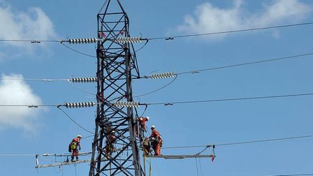 National Grid engineers working on a pylon. Photo: BRIAN PURDY