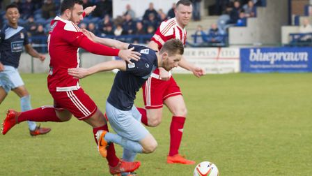 St Neots Town striker Tom Meechan gets away from a Stourbridge defender. Picture: CLAIRE HOWES