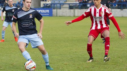 Dylan Williams on the ball as St Neots Town bowed out of the FA Trophy. Picture: CLAIRE HOWES