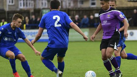 Zane Banton is closed down by three Chippenham Town defenders. Picture: BOB WALKLEY
