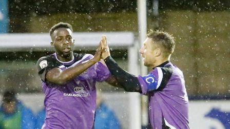 Rhys Murrell-Williamson celebrates his thunderbolt of a goal with skipper David Noble to secure a po