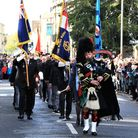 Three flag bearers band together in Royston's moving march through the town for Remembrance Sunday
