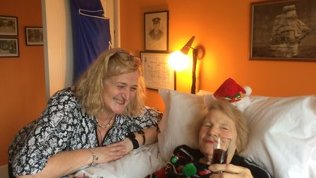 Betty in her Christmas finery with her Rennie Grove nurse Suzanne Fitzpatrick.