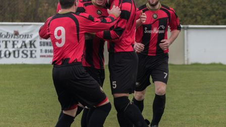 Huntingdon Town players celebrate their opening goal against Bugbrooke. Picture: J BIGGS PHOTOGRAPHY