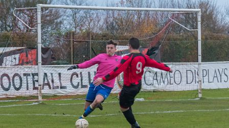 Huntingdon Town man Glenn Spearink brings the Bugbrooke goalkeeper into action. Picture: J BIGGS PHO