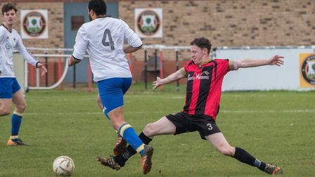 James Seymour at full-stretch during Huntingdon Town's draw against Bugbrooke. Picture: J BIGGS PHOT
